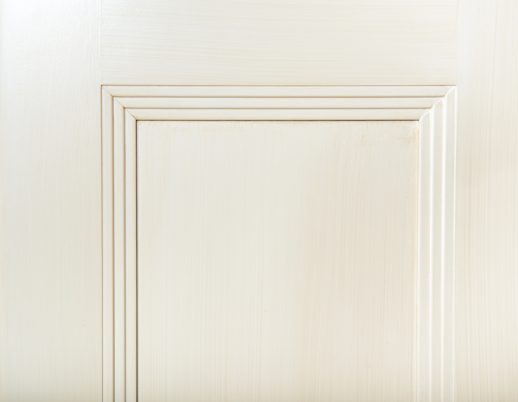 Hand-brushed finish for two cabinetry collections