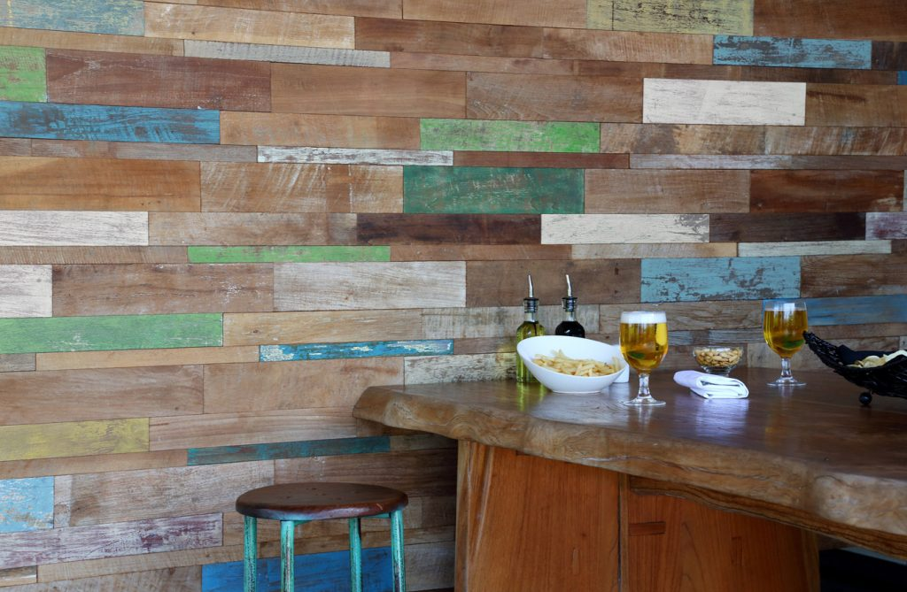 Salvaged timber repurposed as wall cladding