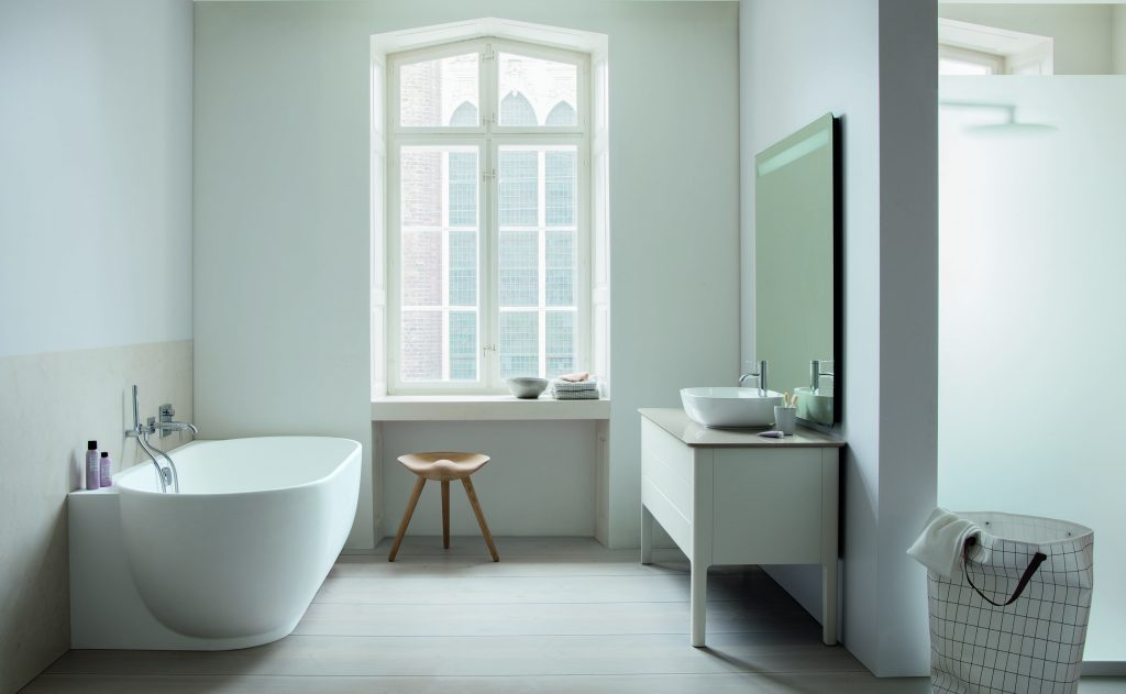 Bath series defined by muted colors, curved shapes