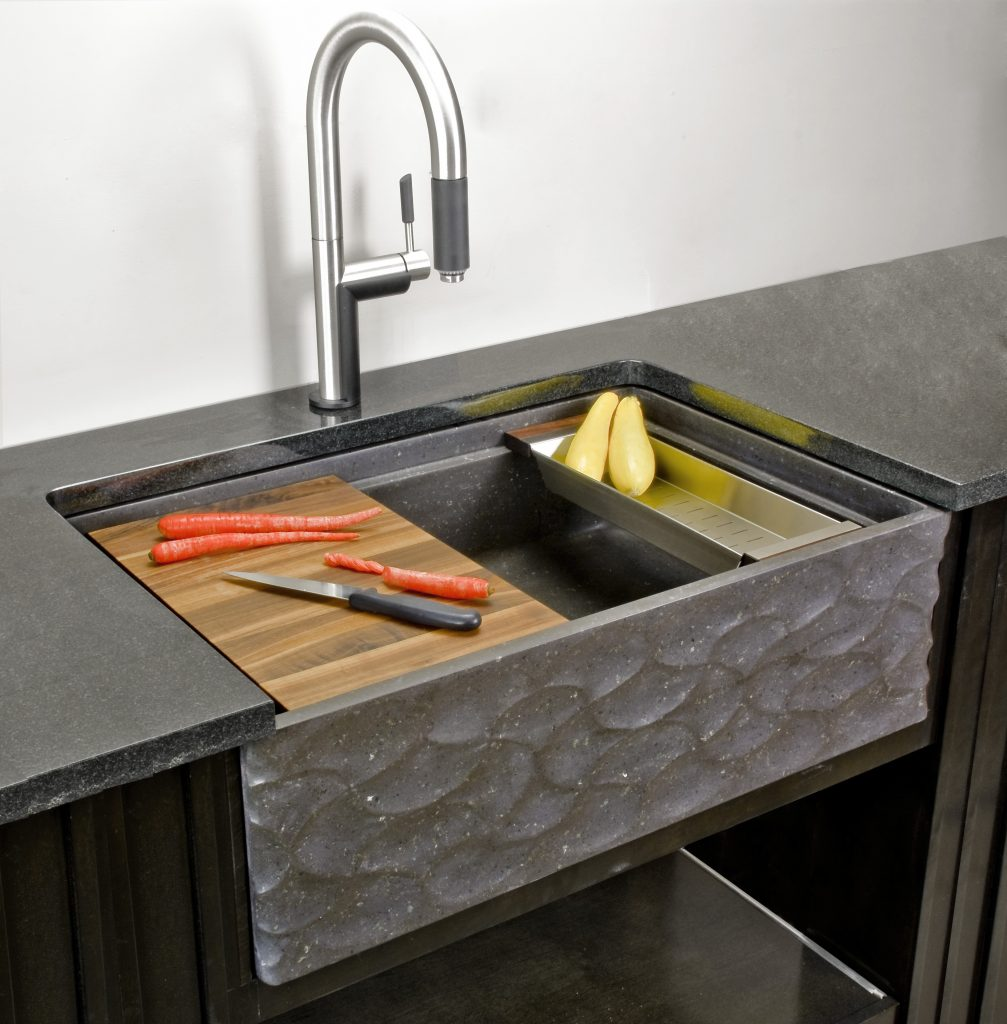 Carved stone apron front sinks