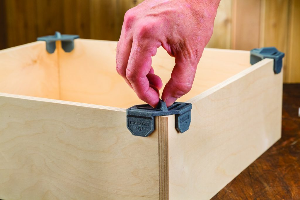 Clips simplify drawer, box, cabinet assembly