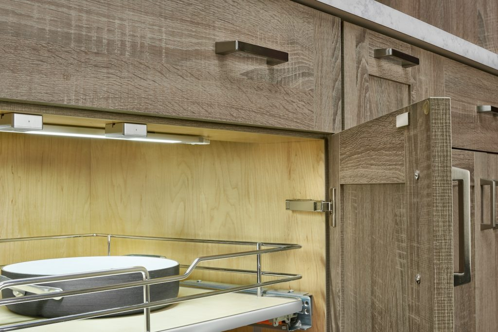 Door sensors automatically turn on light inside cabinets