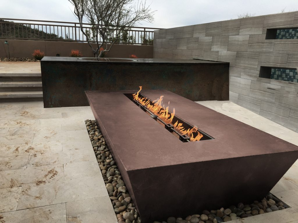 Fire elements, planters, water features heat up outdoor living