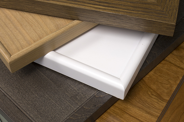 Cabinet doors attach thin frame to veneer panel