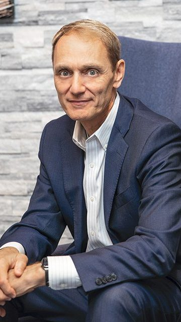 Timothy Wenhold is chief operating officer of Power Home Remodeling Group. He joined the company as CIO after his outside firm built the company's operating systems. The company's technology group now numbers 200 employees.
