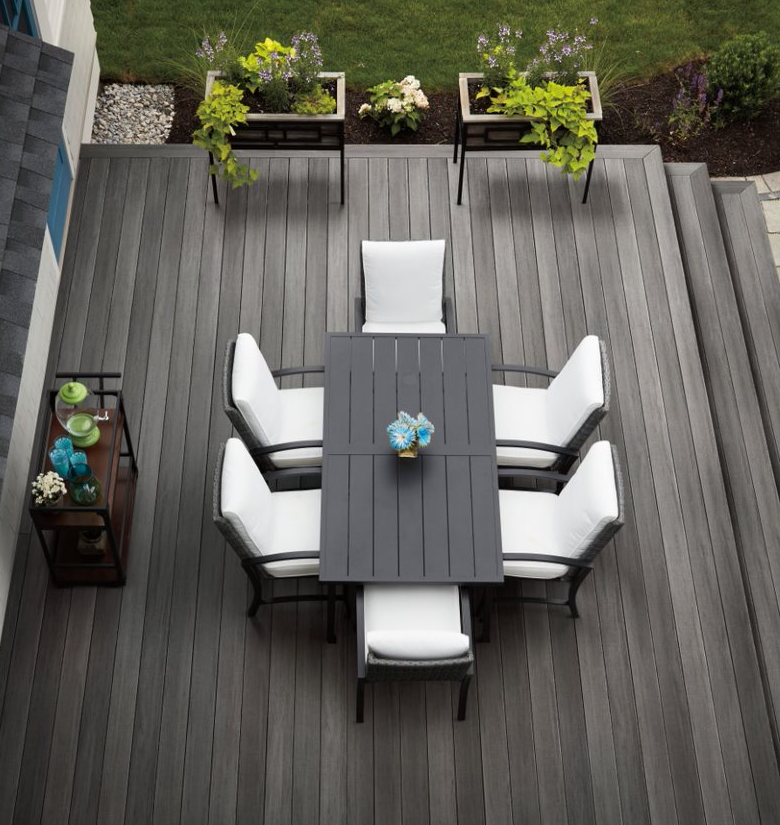 Capped polymer decking features wire-brushed, low-gloss finish